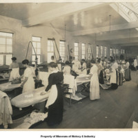 1917 Women using steam press for laundry work
