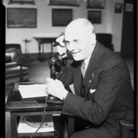 William O. McKay, auto dealer, with telephone, possibly in Seattle, 1932